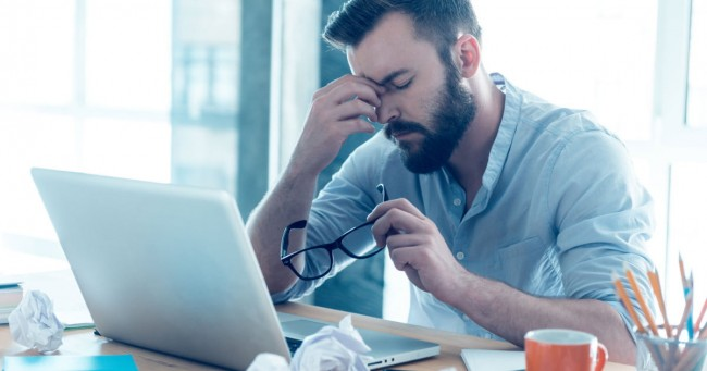 exhausted-man-computer-problems-desk-hacking-hackers-malware-frustration-1200x630-c